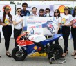 Ng (middle) and Shell Advance ATC riders Fakhrusy Rostam (fourth from left), Helmi Azman and Shafiq Rasol (sixth and seventh from left) launching the contest recently.