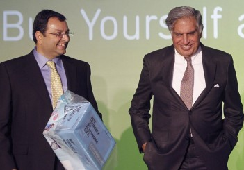 Tata Group Chairman Tata and Deputy Chairman Mistry attend the launch of a new website for tech superstore Croma in Mumbai