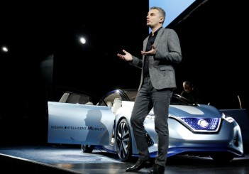 Ogi Redzic, Senior Vice President of Connected Vehicles and Mobility Services for Renault-Nissan Alliance, has a conversation with a Nissan IDS prototype vehicle during a Nissan keynote address at the 2017 CES in Las Vegas