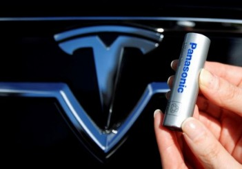 FILE PHOTO A Panasonic Corp's lithium-ion battery is pictured with Tesla Motors logo in Tokyo