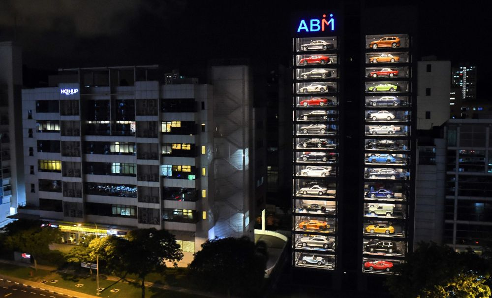 Luxury supercars are displayed inside the AutoBahn Motors (ABM) building in Singapore on May 18, 2017. The building, which resembles an automobile 'vending machine' houses 60 of the million-dollar supercars owned by ABM owners Gary and Jack Hong, who invented the Automotive Inventory Management System (AIMS). / AFP PHOTO / ROSLAN RAHMAN